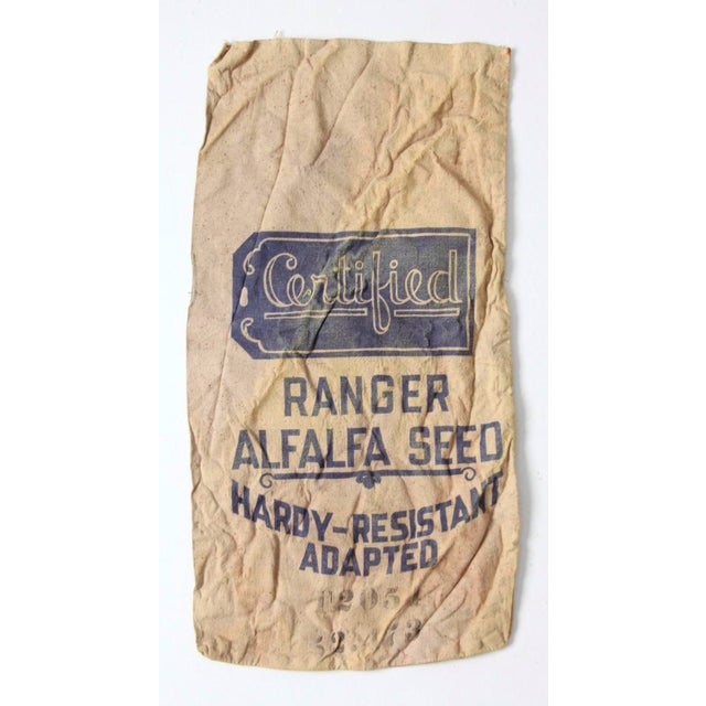 A Certified Ranger alfalfa seed bag. The vintage cotton farm sack features an aged blue graphic print.