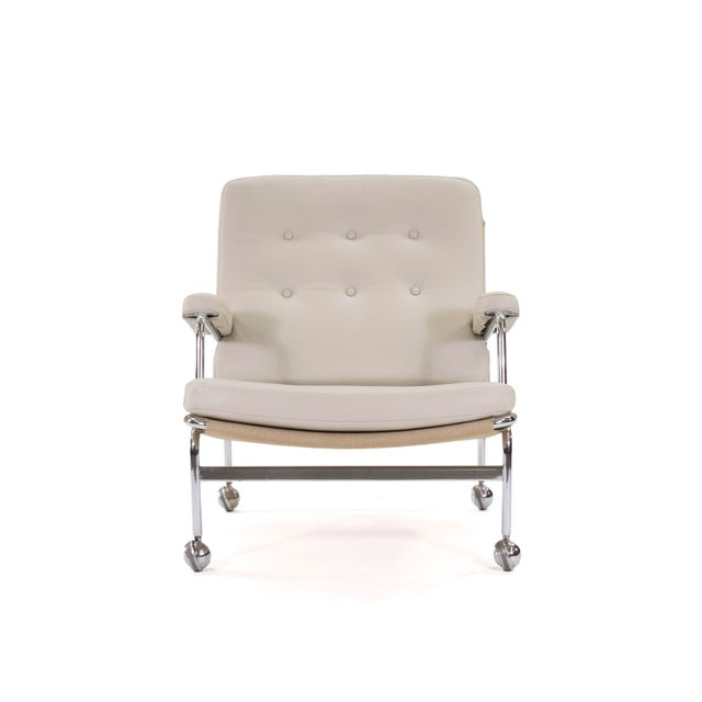 """This listing is for a pair of """"Karin"""" model lounge chairs in new cream leather. This model was the first of many great..."""
