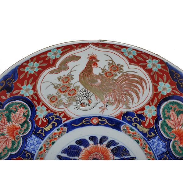A Nineteenth Century Japanese Imari Porcelain charger. The piece is finely decorated with robust colors. Condition is...