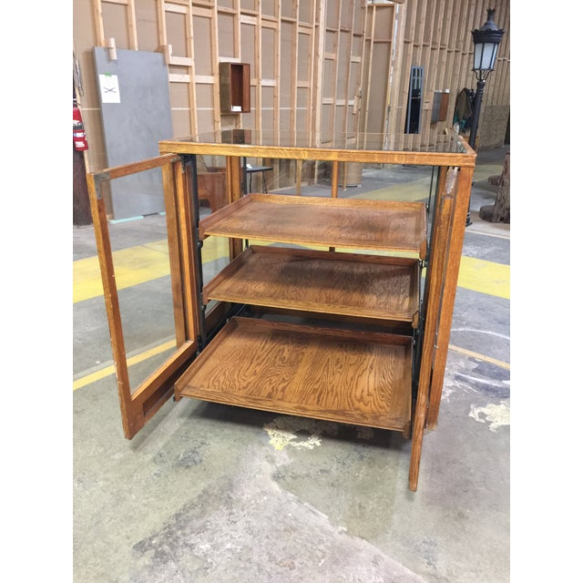 A very rare oak display from Saratoga Springs NY. This display once held either shirts or baked goods. It has 3 drawers...