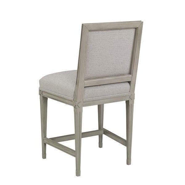 Simply elegant counter stool in the style of Louis XVI with tall, upright back and square seat, and long straight legs...