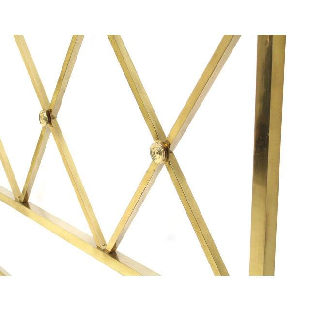 Very nice heavy brass construction light looking X-pattern headboard.