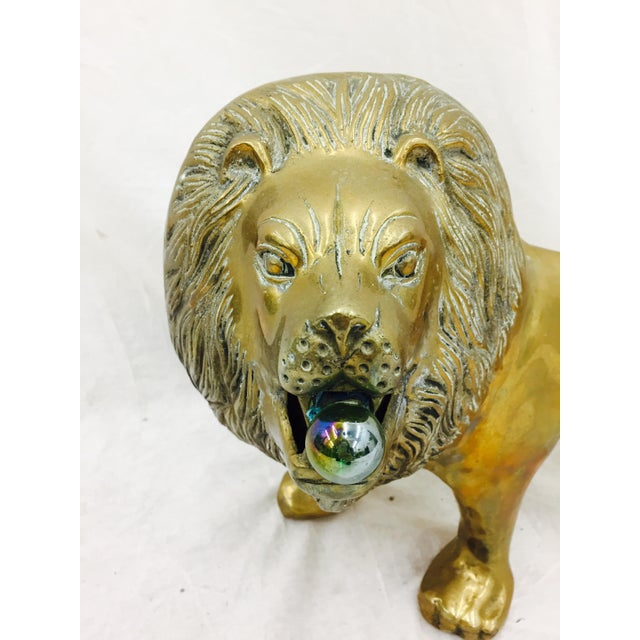 Stunning Vintage Mid Century Modern Brass Lion Sculpture. Lions mouth is open with large vintage iridescent glass marble /...