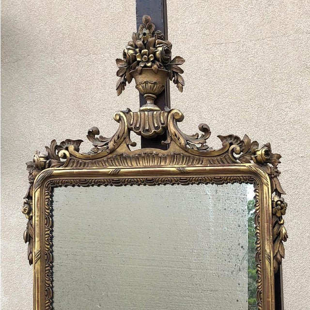 19th Century Italian Carved Giltwood Mirror features a classic, timeless look, and is sized to be very versatile in your...