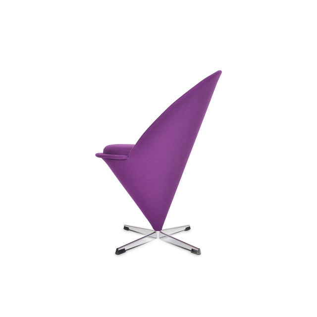 Fully restored in to its original glory, this cone chair by Verner Panton has been newly recovered in provocative purple...