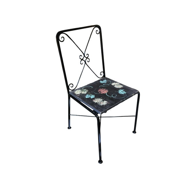 A set of four Scrolling rod iron patio chair with distinct scrolling backrest and Googie style fabric seat. This chair is...