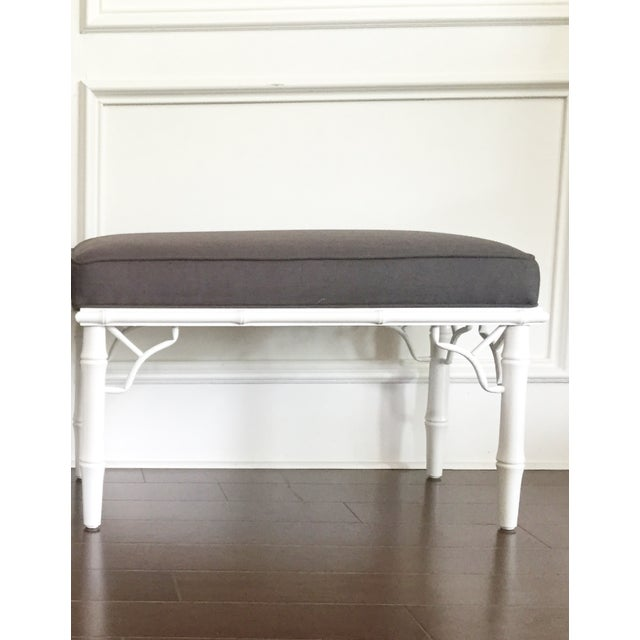 This beautiful vintage faux bamboo bench has soft white painted legs and 100% linen upholstered seats. With very nice...