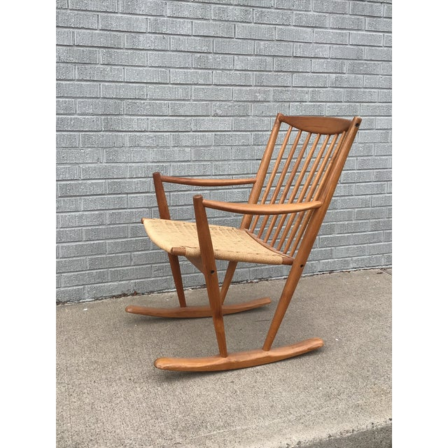Beautiful and stylish Mid-Century Danish Modern corded seat teak rocking chair in excellent condition.