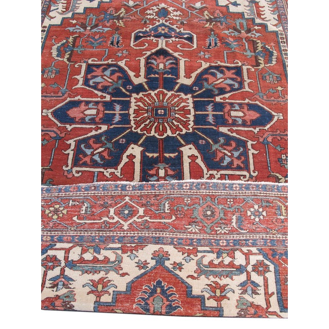 Woven in the vicinity of Heriz in the far northwest of Persia, this Serapi carpet draws a classic indigo eight-pointed...
