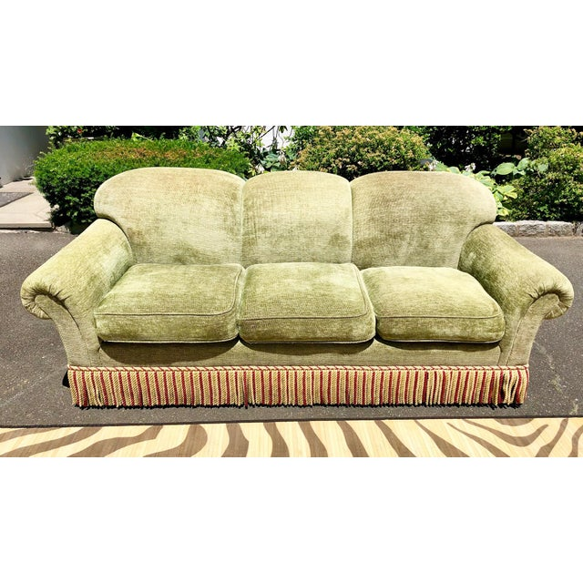 A timeless classic sofa by Edward Ferrell. Upholstered in green chenille with fringe in brick red, tan and green. The most...