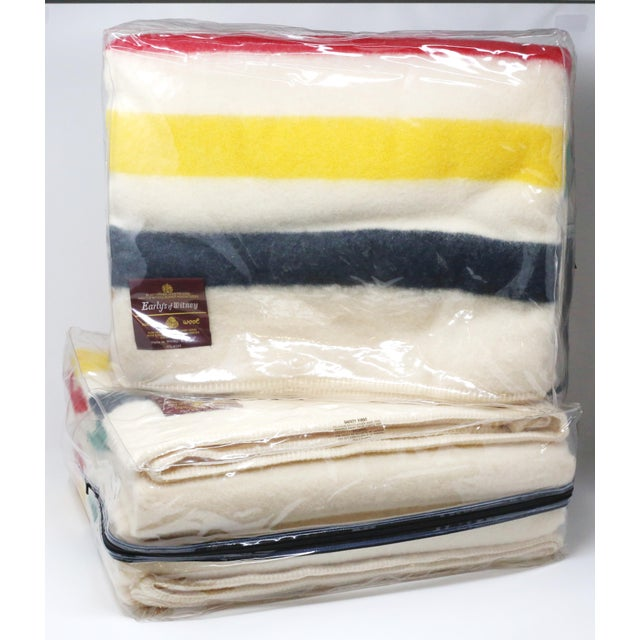 A pair of never-used, new old stock color stripe wool blankets by Early's of Whitney, both in the original packaging. They...