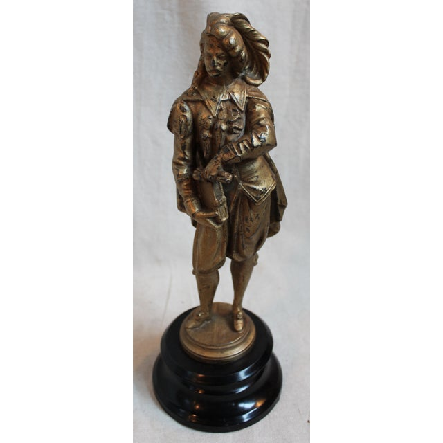 Renaissance gentleman, gilt Spelter figure, ebonaized steel base, late 19th c.
