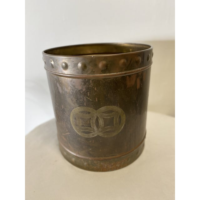 Mid Century Brass Cachepot with embossed decorative borders on top and bottom.