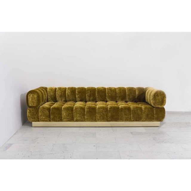 This custom original tufted sofa is the single-base option for Todd Merrill's unique, and customizable seating design....