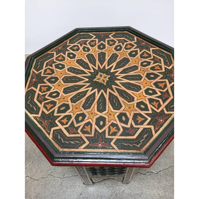 Moroccan colorful hand-painted dark green side table with Moorish design and open fret mousharabie work on sides. Dark...