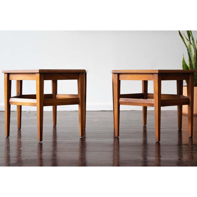 End tables from Drexel Heritage in a lovely warm walnut finish. Hexagon top with coordinating tapered hexagon shaped legs...