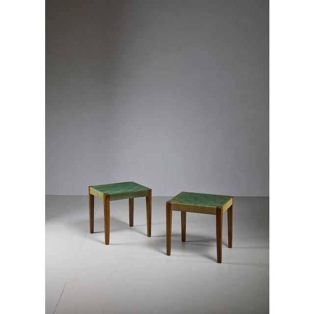 A pair of stools by Axel Larsson for Svenska Möbelfabriken, Bodafors, designed circa 1929. The stools are made of stained...