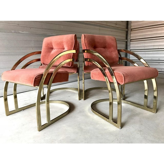 Stylish 4 curved brass cantilever dining chairs attributed to Milo Baughman. All four chairs are strong and stable....