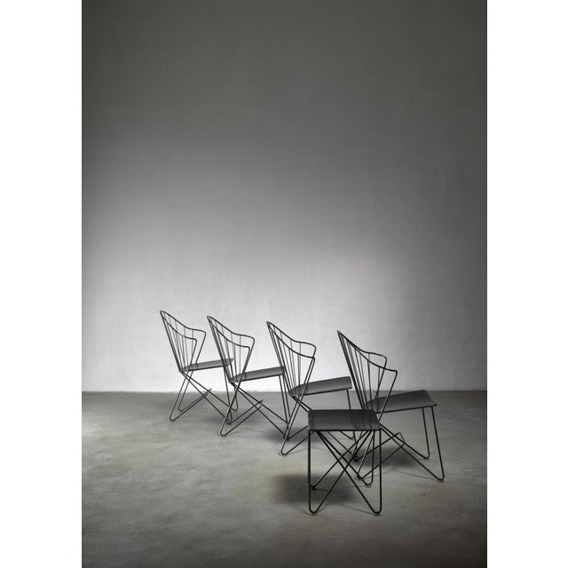 A set of four 'Sonett' chairs and a side table by Mannhardt Stahlmöbel, Germany. Designed by J.O. Wladar and V....