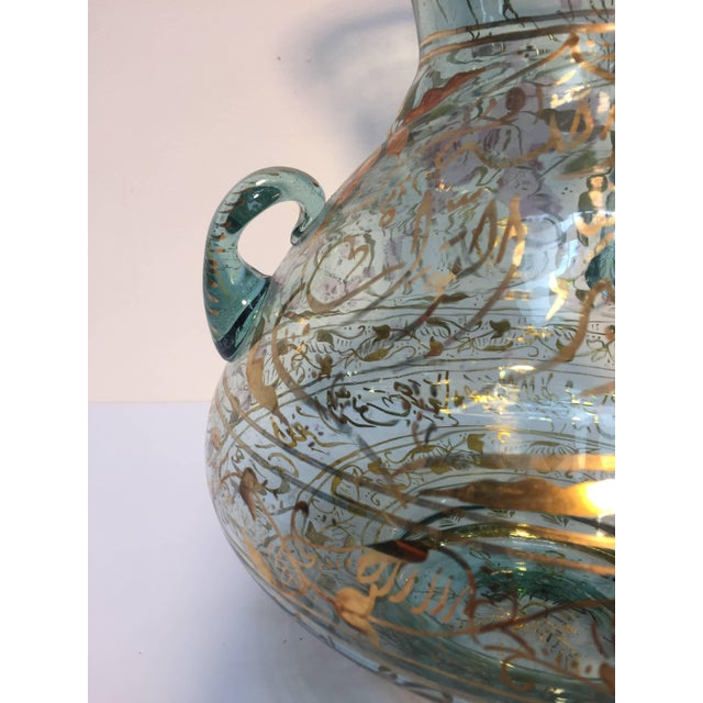 Mosque lamp in the Islamic tradition, Mamelouk style hand painted blown clear glass with gilded calligraphic inscriptions....