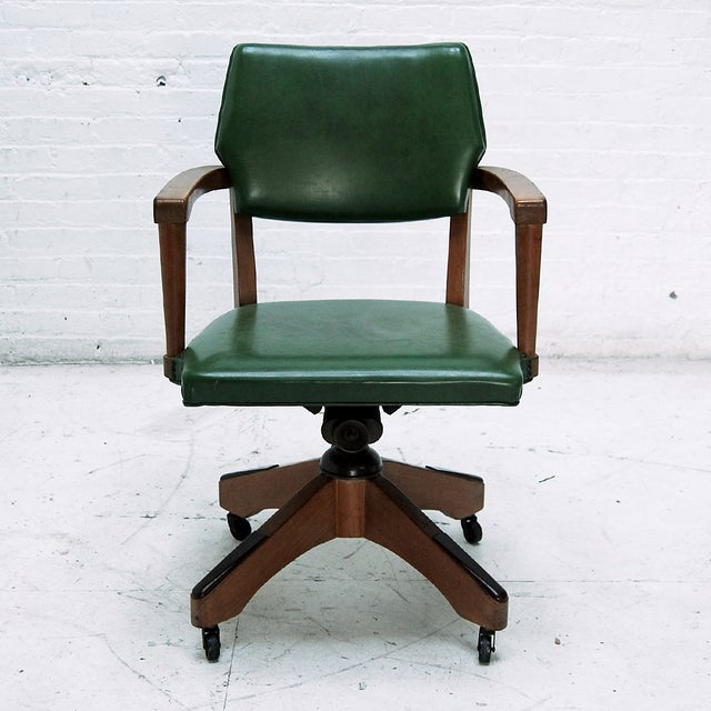 A Mid Century Hillcrest Captains Desk Chair in Green Leather and Oak. Circa 1950.