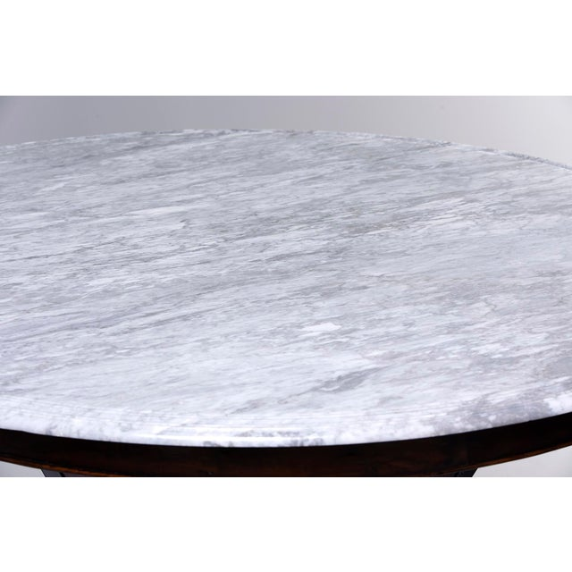"""Circa 1970s white marble round top with gray veining is 63"""" diameter. We had an English cabinet maker design and build a..."""