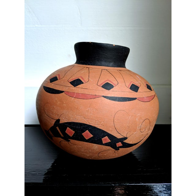 A stunning example of Mexican earthenware pottery, rendered in the Mato Ortiz tradition. This terracotta beauty features...