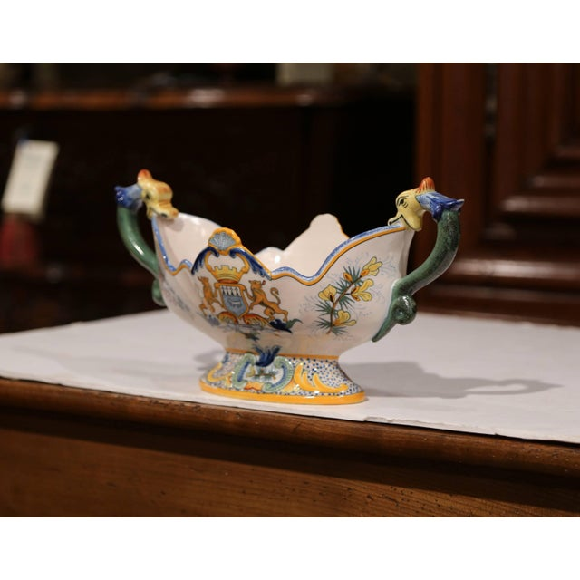 This antique ceramic planter was crafted in Brittany, France, circa 1870. Oval in shape, the colorful jardinière has two...