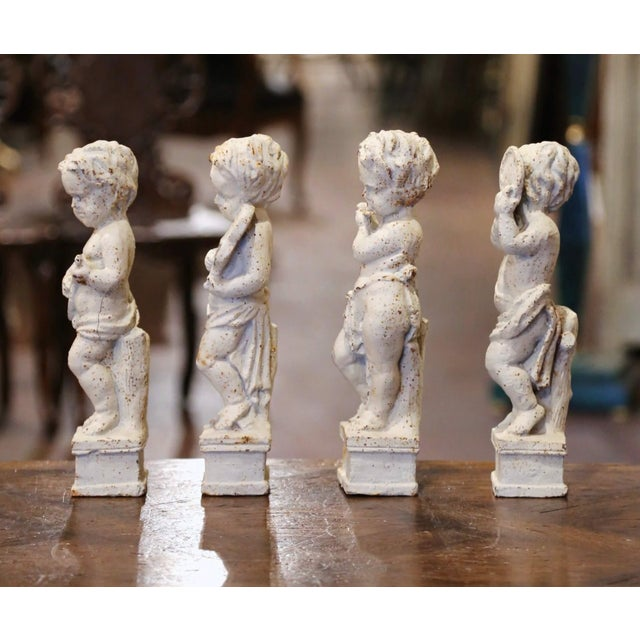 Decorate an office or study's shelf with this elegant suite of antique putti statues. Crafted in France circa 1870, and...