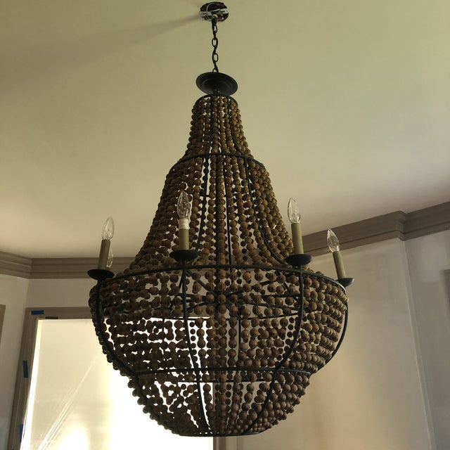 Falconwood Chandelier by Currey & Company DIMENSIONS: 32rd x 44h NUMBER OF LIGHTS: 8 MATERIAL: Wrought Iron/Wood FINISH:...