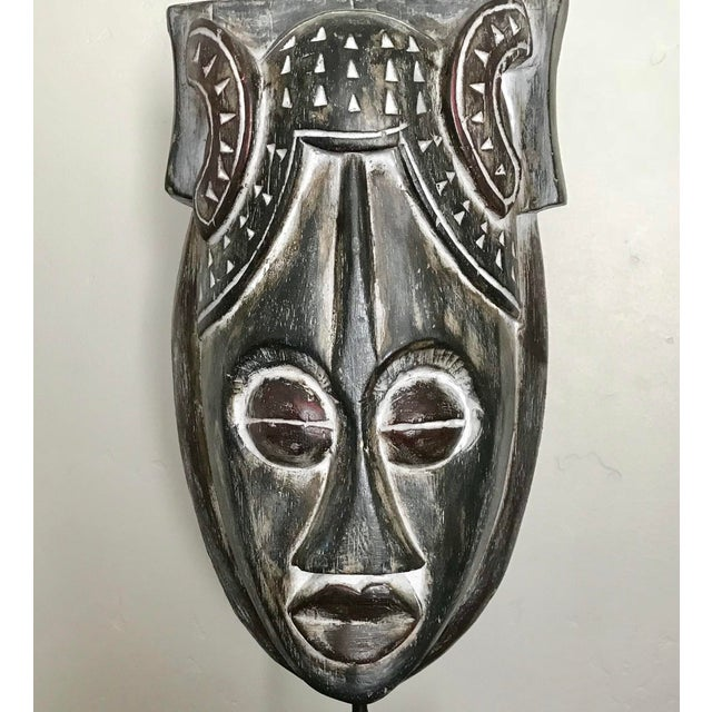 Black whitewash African Mask on a wood stand. Size of mask itself: 7x11x4