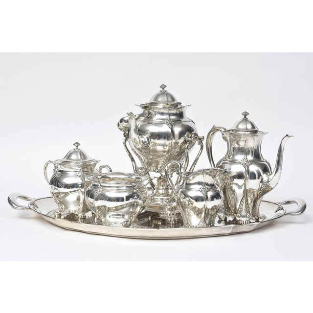 Victorian Tiffany & Co. sterling silver six-piece coffee and tea set. Pattern has applied grapes and vines, fluted edges,...