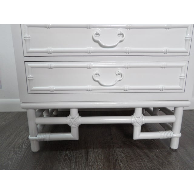 Three Drawer Nightstand with New Crisp White Lacquer Finish. The Chest sits upon a decorative bamboo base. The new finish...