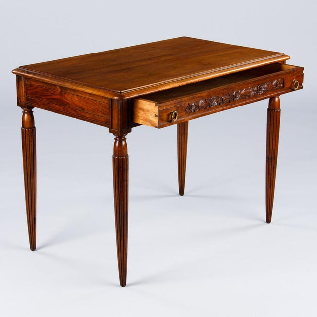 A very elegant desk in the Louis XVI style found in the Loire Region, circa 1900s. The desk is made of walnut and rests on...