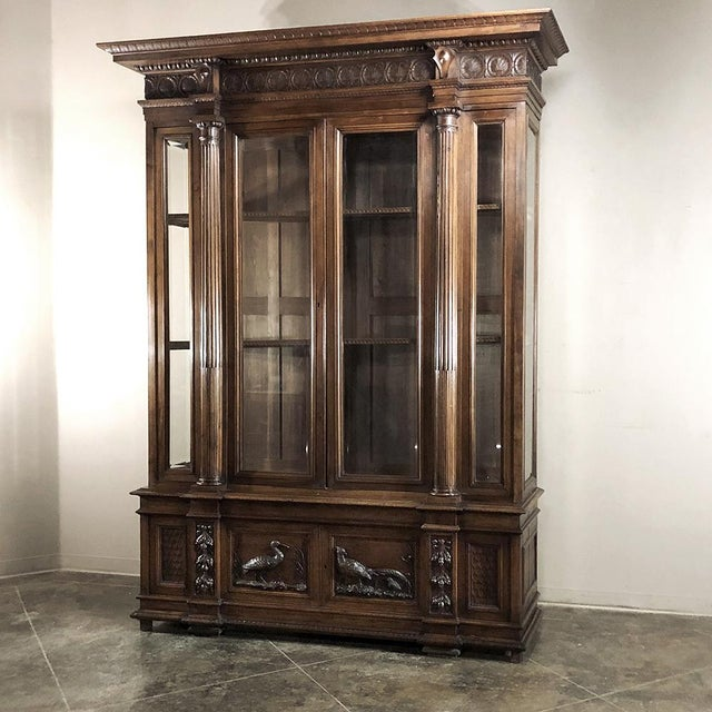 Grand 19th Century Italian Walnut Neoclassical Bookcase is a study in the artistic sculpture of Northern Italy. Wildlife...