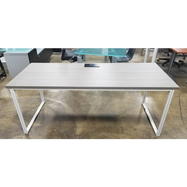 Industrial desk series is made of deep grained wood tops and thin steel frames. From West Elm contract office furniture...