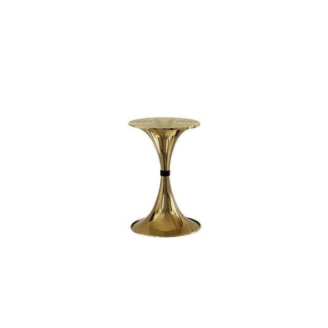 The elegant shapes, clean lines and glossy brass of the Botti Side Table truly embodies what an Essential piece is, a...