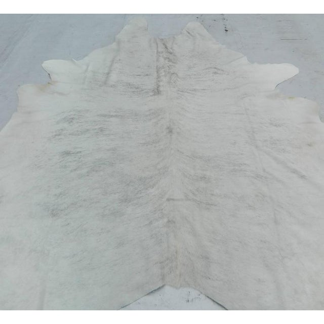New Gray and White cowhide rug, made in Brazil Size: 89'' L X 69'' W.