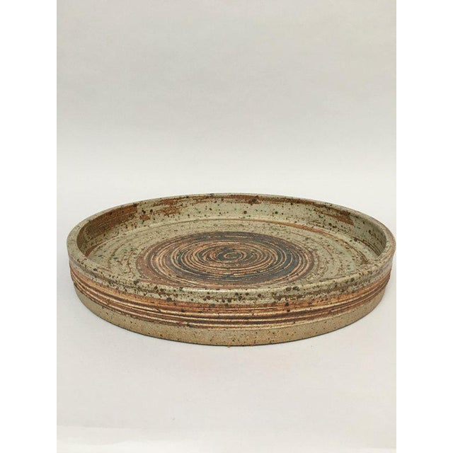 Huge, rustic, modern hand-thrown tray from well-known Danish pottery studio Tue Keramik, ca. 1970s. The tray features a...