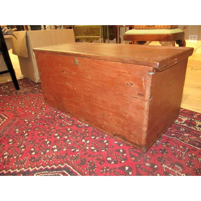Handsome 19th century american painted trunk with lovely worn painted finish having a rectangular lift top over the...