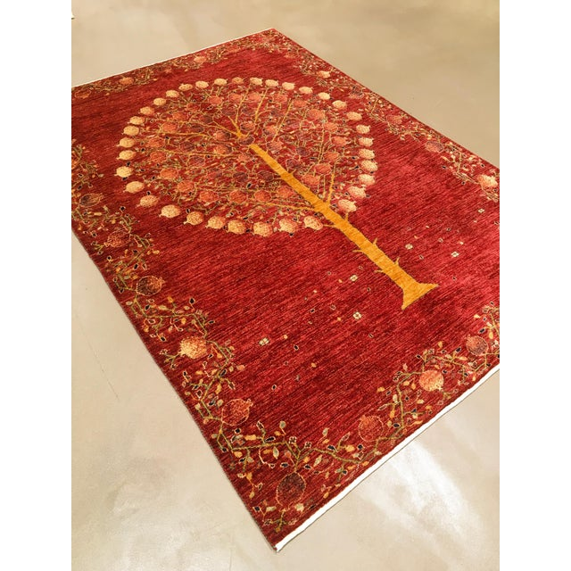 An unusual pictorial depicting a pomegranate tree in full bloom. A modern rug in excellent, unused condition. Great for a...