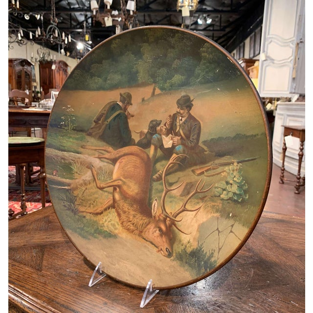 This large colorful platter was created in Germany circa 1920, round in shape, the black forest plate depicts a hand...