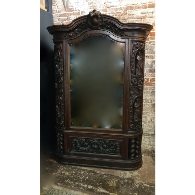 """18th century Highly carved French Gothic Oak cabinet w/Santos & Angels Figures Measures 53""""w x 19""""d x 90""""h A beautiful..."""