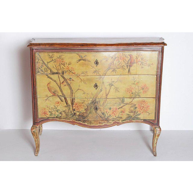 This delightful 18th century Italian commode features a serpentine front with three functional drawers all hand painted...
