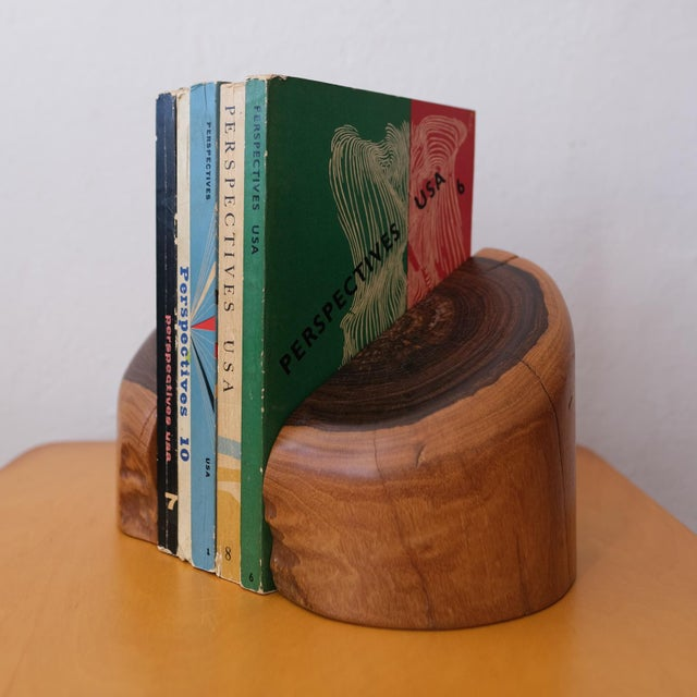 A substantial pair of cocobolo bookends by Don Shoemaker. Produced is his studio in Senal, Mexico. Remnant of a paper...