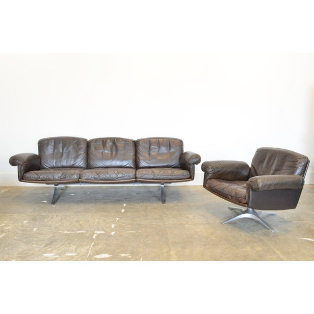 Model DS-31 three-seater leather sofa manufactured by DeSede, Switzerland. Sofa is stationary. materials: dark brown...