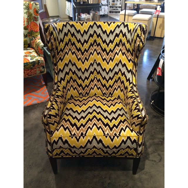 Like a moth to a flame, we can't resist this bright Wesley Hall accent chair. Covered in a three color flame stitch...