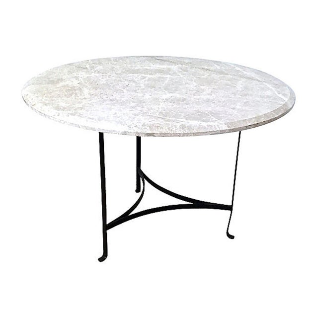Vintage round dining table with travertine top and iron bars. Made in the late 20th century.