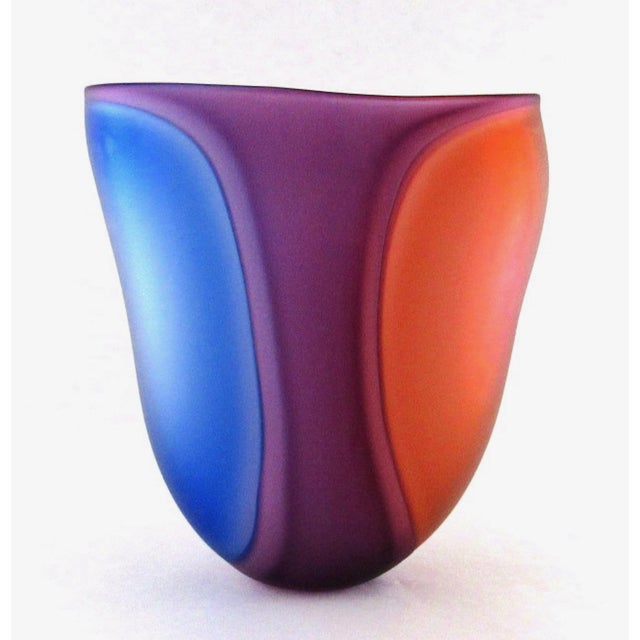 A beautiful Lisa Samphire hand blown cobalt, wine, and red frosted art glass vase. The exterior surface has a satin...