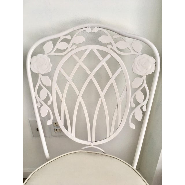 """A lovey vintage wrought iron bistro chairs by Meadowcraft. Under cushions have a label reading """"Meadowcraft Birmingham,..."""